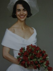 The bride carried red roses.